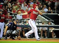 Jun. 29, 2011; Phoenix, AZ, USA; Arizona Diamondbacks batter Stephen Drew hits a solo home run in the sixth inning against the Cleveland Indians at Chase Field. Mandatory Credit: Mark J. Rebilas-