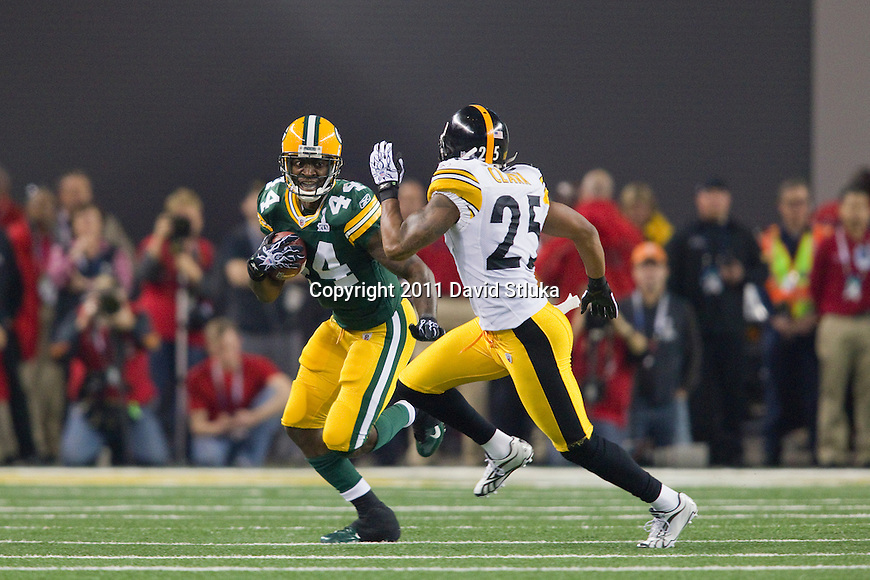 Pittsburgh Steelers defensive back Ryan Clark (25) pursues Green Bay Packers running back James Starks (44) during Super Bowl XLV on Sunday, February 6, 2011, in Arlington, Texas. The Packers won 31-25. (AP Photo/David Stluka)