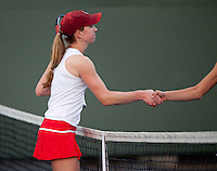 STANFORD, CA - January 26, 2011: Carolyn McVeigh of Stanford women's tennis shakes hands after her match against UC Davis' Lauren Curry. McVeigh won 6-2, 6-1.