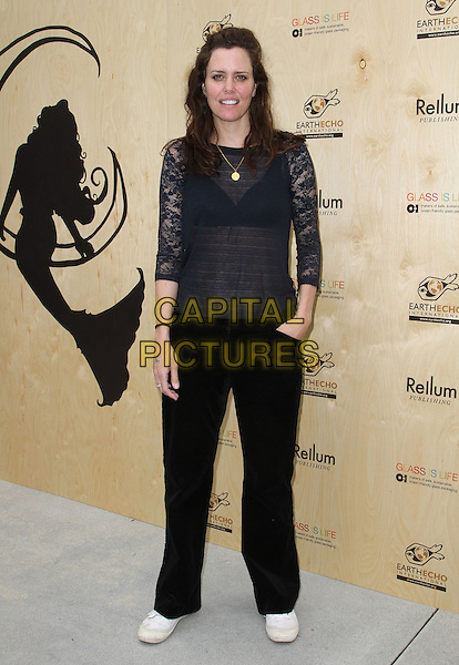 """Ione Skye.Book Party For """"Last Night I Swam With A Mermaid"""" Held at Annenberg Community Beach House in Santa Monica, California, USA..April 22nd, 2012.full length black trousers sheer top blue lace .CAP/ADM/KB.©Kevan Brooks/AdMedia/Capital Pictures."""