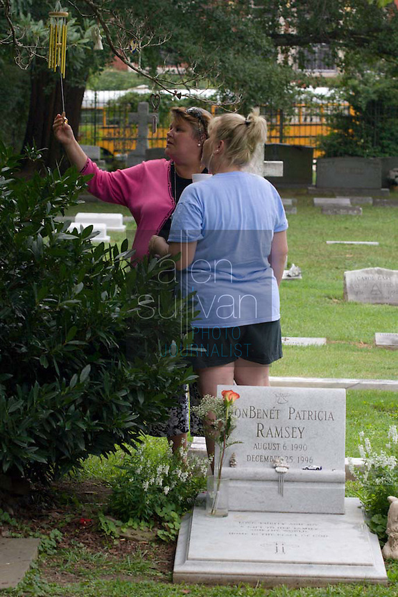 Paulette Paugh Davis, a sister of Patsy Ramsey, at St. James Episcopal Cemetery, where Ramsey and her daughter JonBenet are buried.