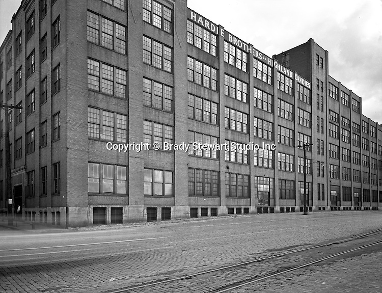 Pittsburgh PA:  View of the Hardie Brothers & Highland Candies Building in the Strip District of Pittsburgh -  1954.  The building was located on Pike Street (Smallman Street today).