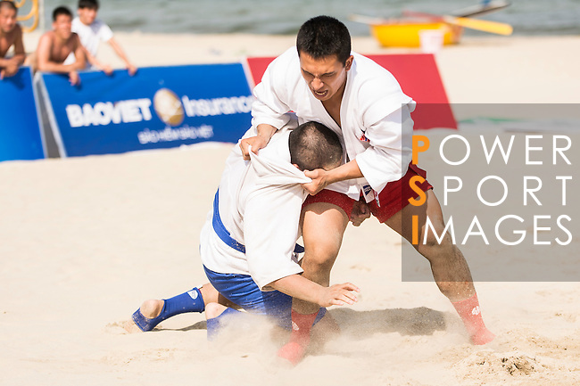 Ie DINH van of Vietnam fights against NISHIMURA Katana of Japan during the Sambo Men's +90kg Round of 16 on Day Nine of the 5th Asian Beach Games 2016 at Bien Dong Park on 02 October 2016, in Danang, Vietnam. Photo by Marcio Machado / Power Sport Images