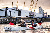 Kayaking on the River Thames at sunset, London, England