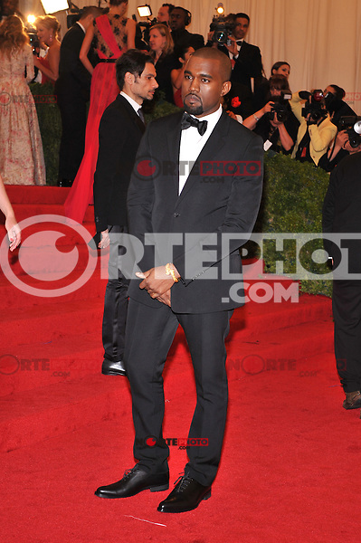Kanye West at the 'Schiaparelli And Prada: Impossible Conversations' Costume Institute Gala at the Metropolitan Museum of Art on May 7, 2012 in New York City. ©mpi03/MediaPunch Inc.