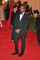 Kanye West at the 'Schiaparelli And Prada: Impossible Conversations' Costume Institute Gala at the Metropolitan Museum of Art on May 7, 2012 in New York City. © mpi03/MediaPunch Inc.