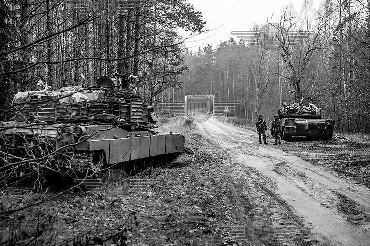 Lithuanian soldiers with armoured vehicles during NATO Iron Sword joint exercises.