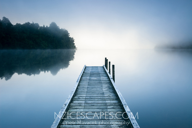 Misty morning at Lake Mapourika jetty near Franz Josef Glacier village, Westland Tai Poutini National Park, West Coast, UNESCO World Heritage Area, New Zealand, NZ