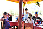 A few families from Vinales, Cuba who rent rooms in their homes to the steady flow of tourists, share a relaxing lunch at a restaurant in the nearby countryside.