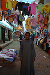 Young boy in the Sharia Souk in Luxor.The town of Luxor occupies the eastern part of a great city of antiquity which the ancient Egytians called Waset and the Greeks named Thebes.
