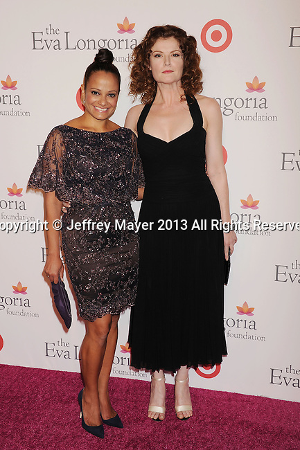 HOLLYWOOD, CA- SEPTEMBER 28: Actresses Judy Reyes (L) and Rebecca Wisocky arrive at the Eva Longoria Foundation Dinner at Beso restaurant on September 28, 2013 in Hollywood, California.