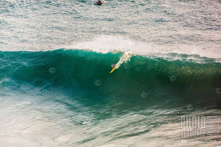 A surfer rides a wave at the 2016 Big Wave Eddie Aikau Contest, Waimea Bay, North Shore, O'ahu.