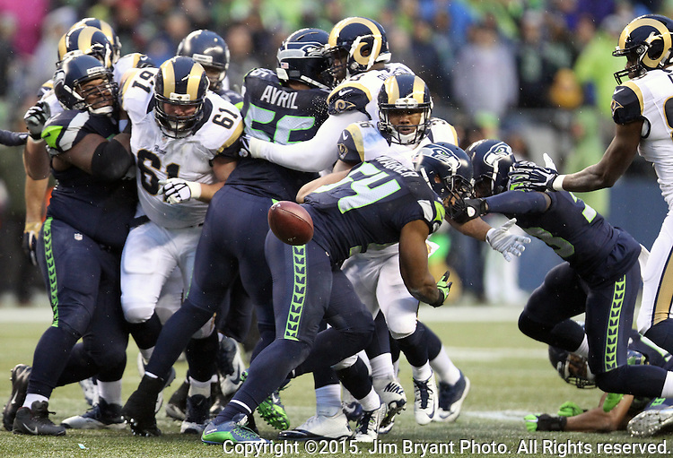 St. Louis Rams running back Benny Cunningham (36) fumbles the ball against the Seattle Seahawks before being tackled by linebacker Bobby Wagner (54) at CenturyLink Field in Seattle, Washington on December 27, 2015.  The Rams beat the Seahawks 23-17.      ©2015. Jim Bryant Photo. All Rights Reserved