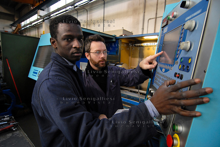 Brescia / Italia 2014<br /> Un rifugiato proveniente dal Senegal assistito dall'associazione ADL-Brescia ha fatto un corso di formazione e trovato lavoro presso una fabbrica meccanica.<br /> A refugee from Senegal assisted by the ADL-Brescia did a training course and found a job at a mechanical factory. <br /> Photo by Livio Senigalliesi