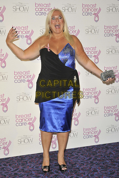 Vanessa Feltz .The Breast Cancer Care 2011 Fashion Show, Grosvenor House hotel, Park Lane, London, England..5th October 2011.full length blue black strapless wrap mouth open hands arms funny silver clutch bag.CAP/CAN.©Can Nguyen/Capital Pictures.