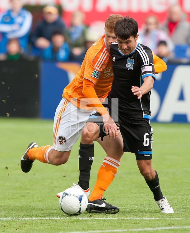 San Francisco, California - Saturday March 17, 2012: Andre Hainault and Shea Salinas fights for the ball during the MLS match at AT&T Park.  Houston Dynamo defeated San Jose Earthquakes  1-0