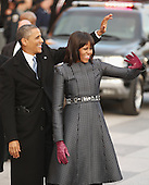 United States President Barack Obama and first lady Michelle Obama wave to supporters as they walk the Inaugural Parade route down Pennsylvania Avenue January 21, 2013 in Washington, DC. President Obama took the Oath of Office earlier in the day during a ceremony on the West Front of the U.S. Capitol. .Credit: Chip Somodevilla / Pool via CNP