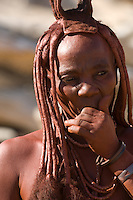 The Himba are a minority group in Namibia, representing less than one per cent of the population. They cover their skin with an ochre dust and, since their hair naturally grows only very short, the women attach extensions of animal hair with an adhesive made from the same dust.