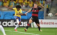 FUSSBALL WM 2014                HALBFINALE Brasilien - Deutschland          08.07.2014 Willian (li, Brasilien) gegen Bastian Schweinsteiger (re, Deutschland)