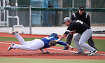 Western Nevada College's Sam Hall dives safely back to first under the tag of College of Southern Idaho's Bodie Cooper during a college baseball game at John L. Harvey Field, in Carson City, Nev., on Friday, March 28, 2014. <br /> Photo by Cathleen Allison/Nevada Photo Source