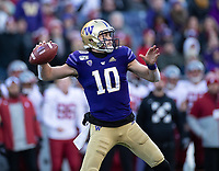Jacob Eason prepares to fire a pass downfield. Eason finished with 244 yards and a passing touchdown.