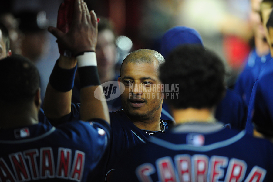 Jun. 27, 2011; Phoenix, AZ, USA; Cleveland Indians batter Orlando Cabrera is congratulated by teammates after hitting a solo home run in the ninth inning against the Arizona Diamondbacks at Chase Field. Mandatory Credit: Mark J. Rebilas-