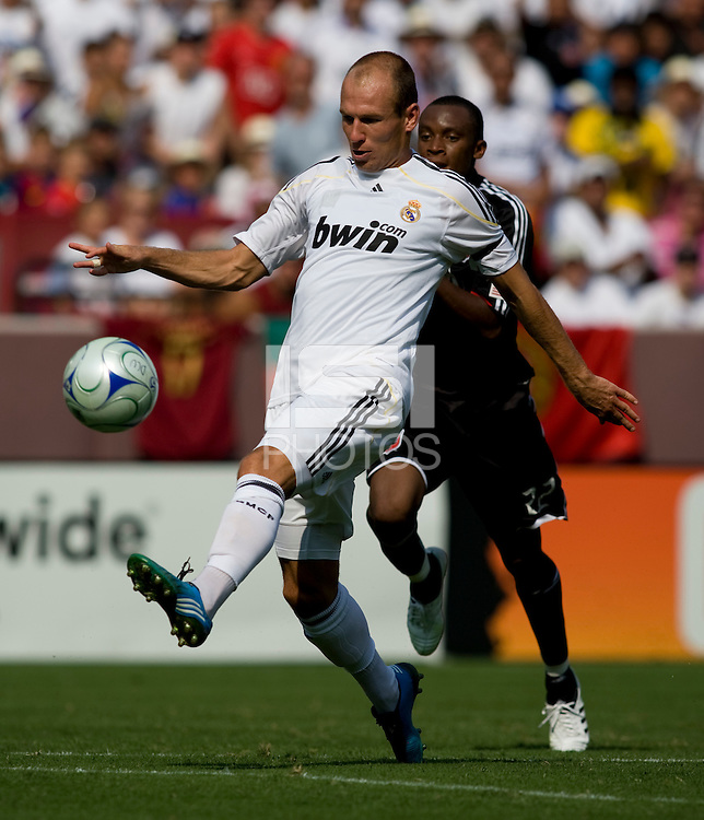 Real Madrid midfielder (11) Arjen Robben chips the ball over the keeper for a goal during their friendly at FedEx Field in Landover, Maryland.  Real Madrid defeated DC United, 3-0.