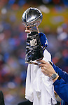 New York Giants Head Coach Tom Coughlin holds up the Vince Lombardi Trophy after beating the New England Patriots during the NFL Super Bowl XLVI football game on Sunday, Feb. 5, 2012, in Indianapolis. The Giants won 21-17 (AP Photo/David Stluka)...