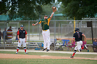 South Vermont Mountaineers first baseman Ryan Serrato (25) jumps for a throw as Bryan Sternig (1) runs up the baseline and coach Ralph Kalal (left) looks on during a game against the Edgewood Eagles on March 18, 2019 at Lee County Player Development Complex in Fort Myers, Florida.  South Vermont defeated Edgewood 19-6.  (Mike Janes/Four Seam Images)