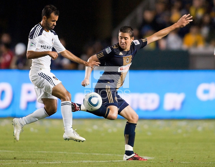 Philadelphia Union midfielder Kyle Nakazawa (13) does battle with LA Galaxy midfielder Juninho (19). The LA Galaxy defeated the Philadelphia Union 1-0 at Home Depot Center stadium in Carson, California on  April  2, 2011....