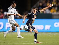 Philadelphia Union midfielder Kyle Nakazawa (13) does battle with LA Galaxy midfielder Juninho (19). The LA Galaxy defeated the Philadelphia Union 1-0 at Home Depot Center stadium in Carson, California on  April  2, 2011....