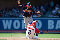 15 March 2009: #8 Akinori Iwamura of Japan jumps over #8 Ariel Pestano of Cuba as he slides to second base during the 2009 World Baseball Classic Pool 1 game 1 at Petco Park in San Diego, California, USA. Japan wins 6-0 over Cuba.