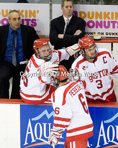Mike Geragosian (BU - Volunteer Assistant Coach), Colby Cohen (BU - 25), Mike Bavis (BU - Associate Head Coach), Joe Pereira (BU - 6), Kevin Shattenkirk (BU - 3) - The Boston University Terriers defeated the University of Michigan Wolverines 3-2 on Saturday, October 24, 2009, at Agganis Arena in Boston, Massachusetts.