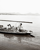 CHINA, Hangzhou, woman with her daughter traveling in a boat on West Lake (B&W)