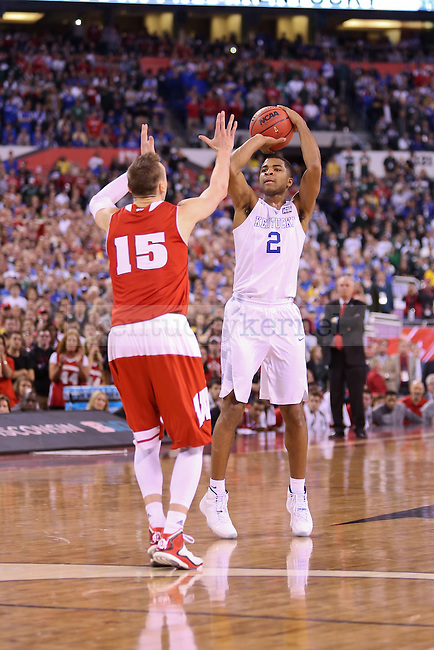 Guard Aaron Harrison of the Kentucky Wildcats shoots a final three in the game against the Wisconsin Badgers in the Final Four of the 2015 NCAA Men's Basketball Tournament at Lucas Oil Stadium on Saturday, April 4, 2015 in Indianapolis, In.  Photo by Jonathan Krueger | Staff.