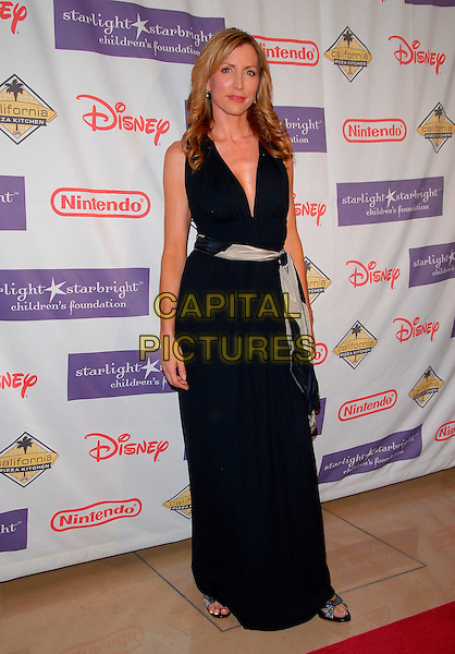 HEATHER MILLS.At the 2007 Starlight Starbright Children's Foundation Gala held at the Beverly Hilton Hotel in Beverly Hills, California, USA, March 23 2007..full length black dress scarf belt tied waist low cut.CAP/DVS.©Debbie VanStory/Capital Pictures