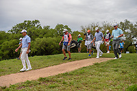Si Woo Kim (KOR), Corey Conners (CAN), and Charley Hoffman (USA) head down 2 during day 4 of the Valero Texas Open, at the TPC San Antonio Oaks Course, San Antonio, Texas, USA. 12/31/2013.<br /> Picture: Golffile | Ken Murray<br /> <br /> <br /> All photo usage must carry mandatory copyright credit (© Golffile | Ken Murray)