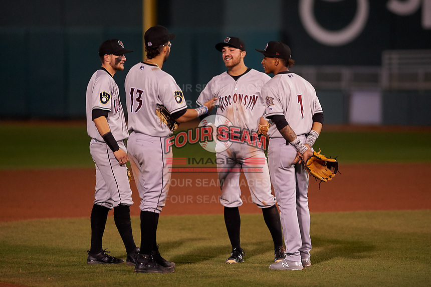 Wisconsin Timber Rattlers infielders Brice Turang (2), Gabriel Garcia (13), Connor McVey (6), and Yeison Coca (1) during a Midwest League game against the Lansing Lugnuts at Cooley Law School Stadium on May 1, 2019 in Lansing, Michigan. Wisconsin defeated Lansing 2-1 in the second game of a doubleheader. (Zachary Lucy/Four Seam Images)