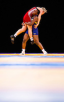 11 DEC 2011 - LONDON, GBR - Annabel Laure Ali (CMR) (in blue) lifts Epp Mae (EST) (in red) during their 72kg category bronze medal bout during the London International Wrestling Invitational and 2012 Olympic Games test event at the ExCel Exhibition Centre in London, Great Britain (PHOTO (C) NIGEL FARROW)