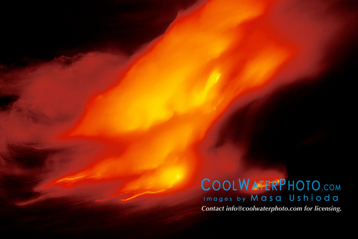 creation of new land, hydromagnetic explosions occur when hot molten lava flows into ocean, Hawaii Volcanoes National Park at night, Kilauea, Big Island, Hawaii..