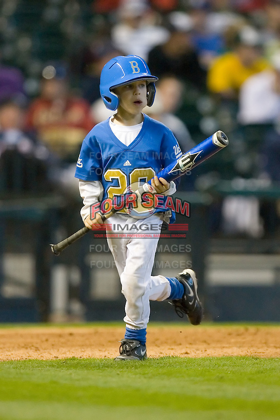 The UCLA Bruins batboy retrieves a bat during game action versus the Baylor Bears in the 2009 Houston College Classic at Minute Maid Park February 28, 2009 in Houston, TX.  The Bears defeated the Bruins 5-1. (Photo by Brian Westerholt / Four Seam Images)