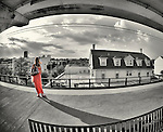 Woman waiting for train on elevated platform of Merrick Station of Long Island Railroad LIRR, dusk on July 16, 2011 NOTE: 180 degree fisheye lens view) EDITORIAL use only