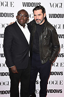 "LONDON, UK. October 31, 2018: Edward Enninful & Roland Mouret at the ""Widows"" special screening in association with Vogue at the Tate Modern, London.<br /> Picture: Steve Vas/Featureflash"