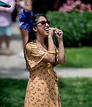 June 8, 2019 : A woman cheers during an undercard race on Belmont Stakes Festival Saturday at Belmont Park in Elmont, New York. Scott Serio/Eclipse Sportswire/CSM