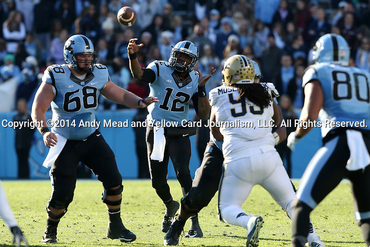 15 November 2014: UNC's Marquise Williams (12) throws a pass over Lucas Crowley (68) and Pitts Khaynin Mosley-Smith (95) towards Jack Tabb (80). The University of North Carolina Tar Heels hosted the University of Pittsburgh Panthers at Kenan Memorial Stadium in Chapel Hill, North Carolina in a 2014 NCAA Division I College Football game. UNC won the game 40-35.