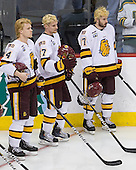 Mike Montgomery (Duluth - 24), David Grun (Duluth - 27), Justin Fontaine (Duluth - 37) - The University of Minnesota-Duluth defeated the University of Notre Dame Fighting Irish 4-3 in their 2011 Frozen Four Semi-Final on Thursday, April 7, 2011, at the Xcel Energy Center in St. Paul, Minnesota.