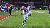 RALEIGH, NC - NOVEMBER 30: Michael Carter #8 of the University of North Carolina races to the locker room after his teammates during a game between North Carolina and North Carolina State at Carter-Finley Stadium on November 30, 2019 in Raleigh, North Carolina.