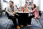 WATERBURY CT. 15 March 2018-031519SV04-From left, Zachary Petrarca, Samantha Martinez, and Kejsi Ozuni listen to speeches during a ceremony of Crosby High School students who were the first group of students to finish future bankers program. The three were part of the program. <br /> Steven Valenti Republican-American