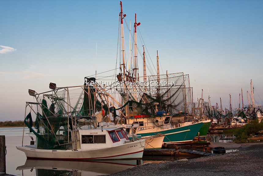 Shrimp boats lined up at dock in Cameron, Louisiana.