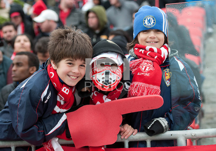 24 March 2012: Some Toronto FC fans braved the cold and wet weather to show their support during the second half in a game between the San Jose Earthquakes and Toronto FC at BMO Field in Toronto..The San Jose Earthquakes won 3-0..